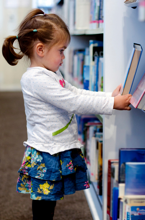 preschool girl selecting book