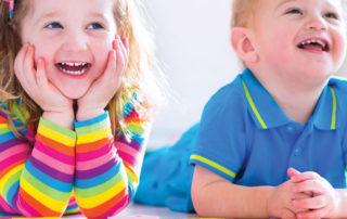 preschoolers smiling with blocks